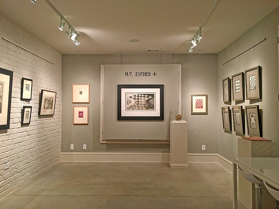 installation view of the M.C. Escher + exhibition at Different Trains, an art gallery in Atlanta, Georgia